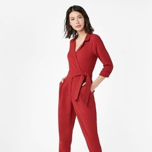 Just Fab woman's red belted jumpsuit with pockets